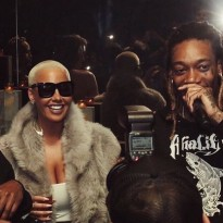 Amber Rose and Wiz Khalifa at a private event thrown by Khalifa.